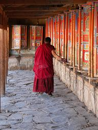 Monk spinning prayer wheels at Labrang Monastery
