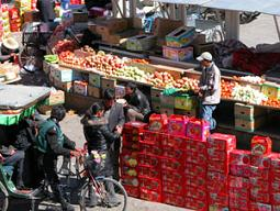 Boxes of apples or oranges are taken to the home of friends during Losar
