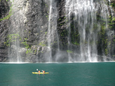Waterfall and Kayak in Geiranger Fjord