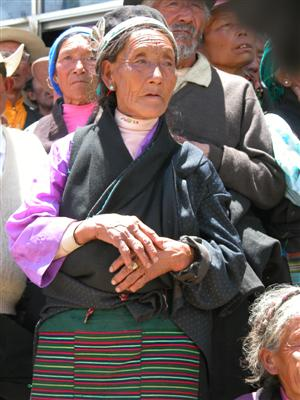 Samye, Tibet - Woman Watching Cham Dancing