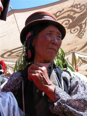 Samye, Tibet - Woman with Grass Hanging from Her Hat