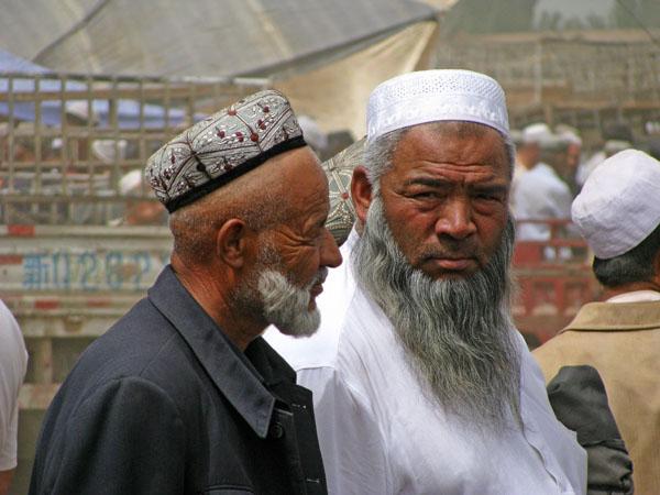 Kashgar, China - Locals at the Sunday Livestock Market