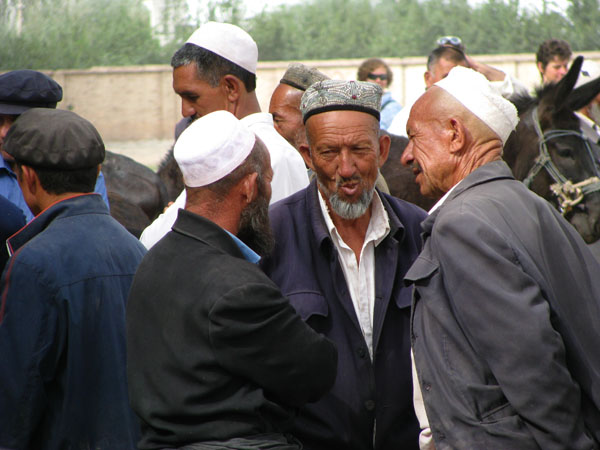 Kashgar, China - Locals at the Sunday Livestock Market