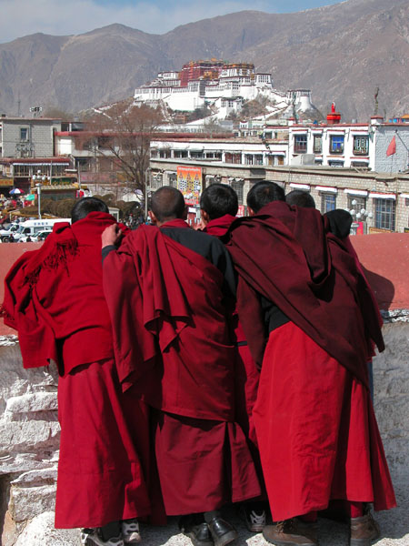 Curious Monks on the Roof of the Jokhang Temple in Lhasa, Tibet