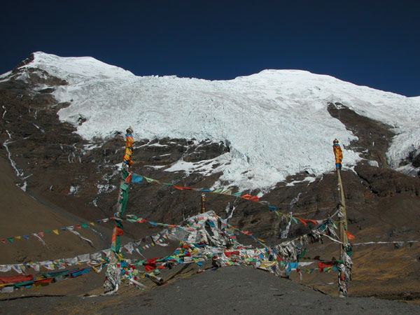 Mountain Stupa and Prayer Flags in Tibet