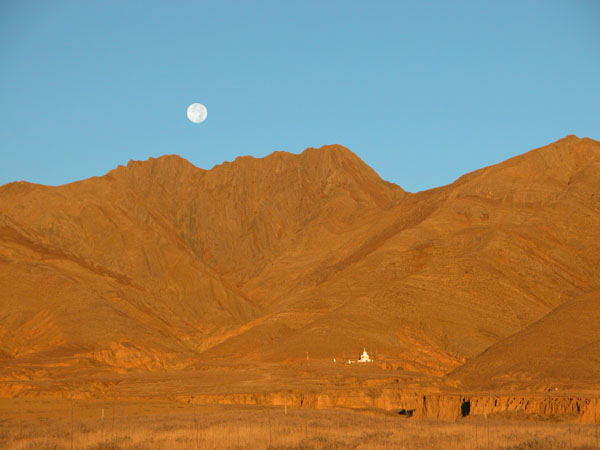 Tibetan Stupa Under a Full Moon